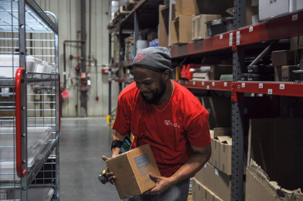 Workers at a Red Stag Fulfillment center
