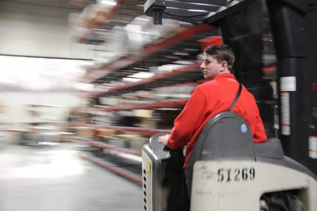 3PL provider warehouse worker in motion
